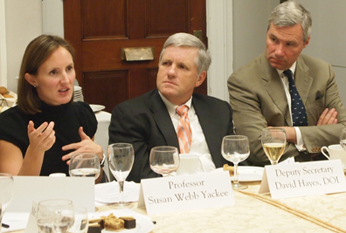 Susan Webb Yackee speaks to federal officials during a dinner on Capitol Hill.