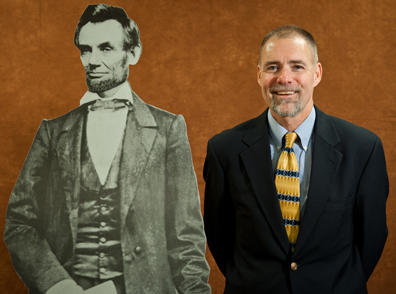 cut-out photograph of Abraham Lincoln on the left and professor Chris Mooney on the right