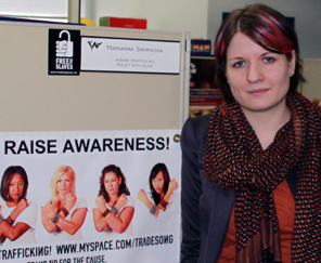 Marianna Smirnova in her office, next to an anti-human trafficking poster.