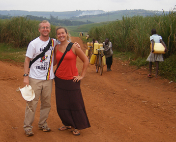 Man and woman standing on rural road in Uganda