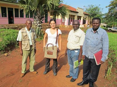 Corina Maxim and three men in front of the district hospital in Mbaikia, Central African Republic