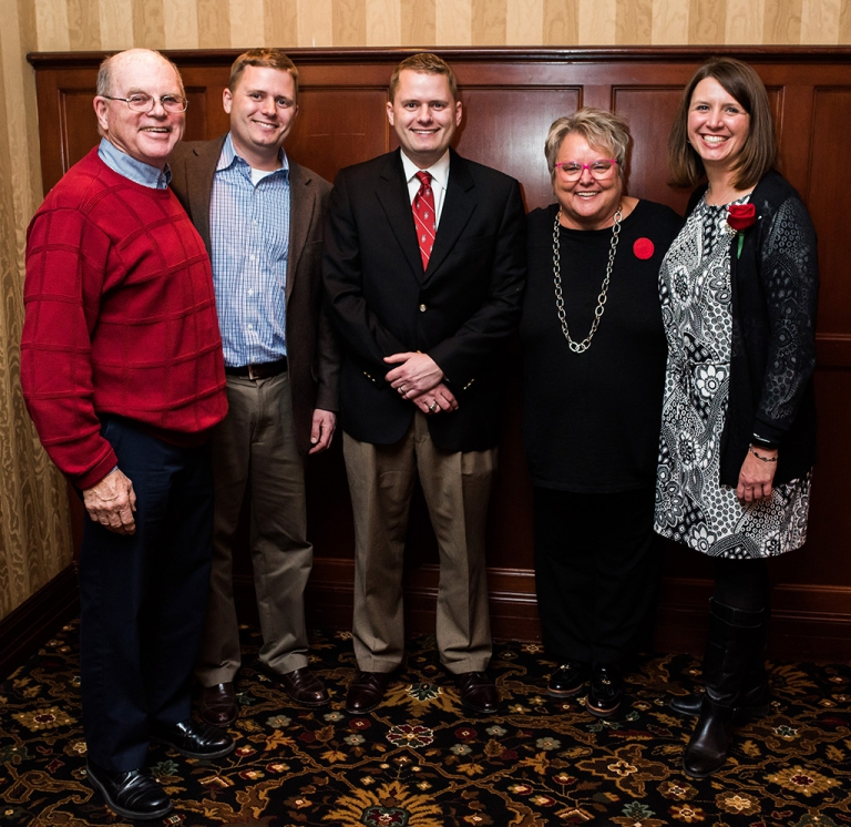From left, Emeritus Professor Dennis Dresang, Eric Tempelis, Peter Tempelis, WAA President Paula Bonner, and Mindy Tempelis celebrate Peter Tempelis' Forward under 40 Award.