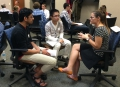 Students Kaubin Neupane and Xin Nong talk with 2011 alum Sylvia Ramirez at the speed-networking session that is part of the La Follette School's professional development course.