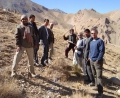 Bill Schmitt (right) stands with local men while working on a watershed project in Bamiyan, Afghanistan.