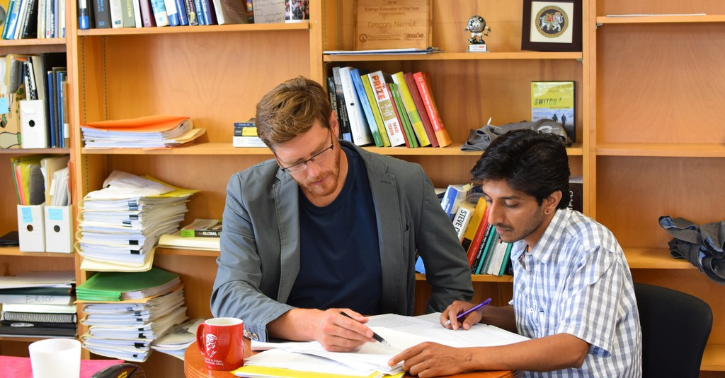 Rohan Rao, right, serves as Greg Nemet's project assistant for a three-year study assessing the importance of knowledge spillovers in the solar industry and how policies can be designed to address them.