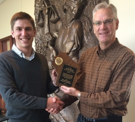 Scott Wood, left, receives a plaque from Wisconsin District Attorneys Association board president David O'Leary.