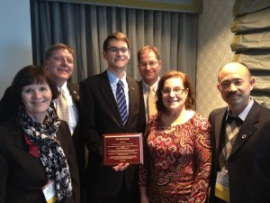 Alex Marach holds the Best Paper Award and stands with Barb Ivanov, Wisconsin Department of Transportation; Ernie Perry, National Center for Freight and Infrastructure Research and Education; Ed Strocko, Federal Highway Administration; Teresa Adams (CFIRE); and Bruce Wang, Texas Transportation Institute.