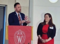 Ryan Tobiasz, president of the Wisconsin Alumni Association DC Chapter, presents the DC Badger of the Year award to Alexis MacDonald (MPA '08) at the Ronald Reagan Building and International Trade Center in DC.