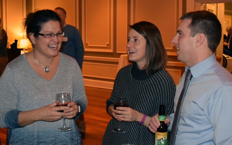 Michele Dickinson, left, chats with fellow alumni at the Madison Reception on February 2, 2017.