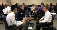 Students Jordan Krieger and Andrew Fisher talk with 2014 alum Steve Kulig (right)